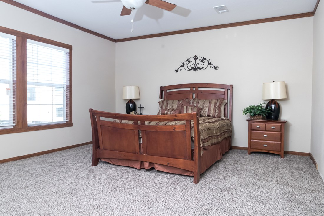 The THE NEWPORT 32 Master Bedroom. This Manufactured Mobile Home features 4 bedrooms and 2 baths.