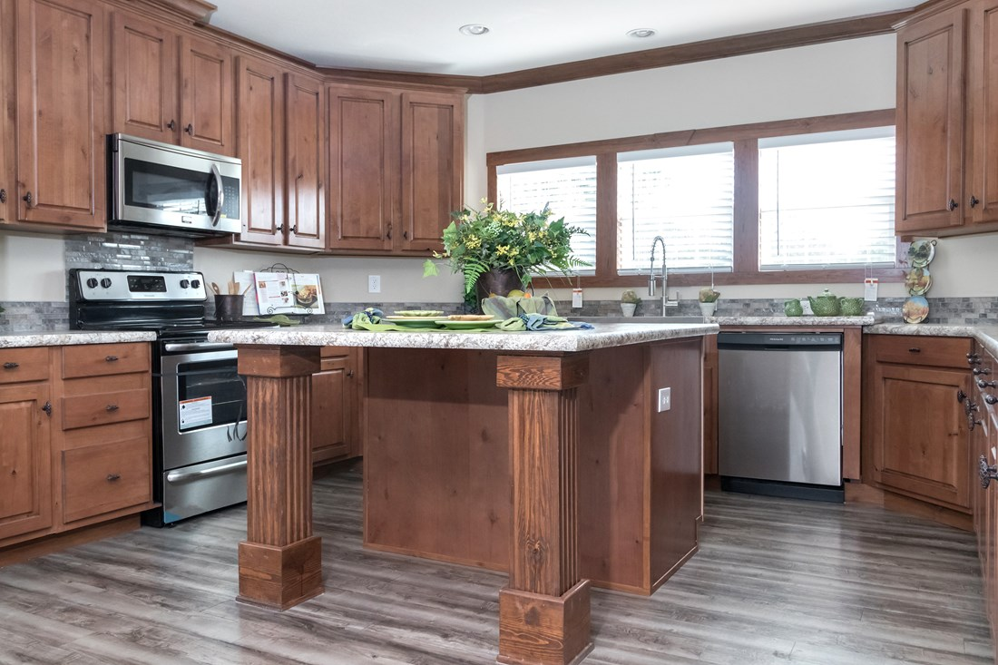The THE NEWPORT 32 Kitchen. This Manufactured Mobile Home features 4 bedrooms and 2 baths.