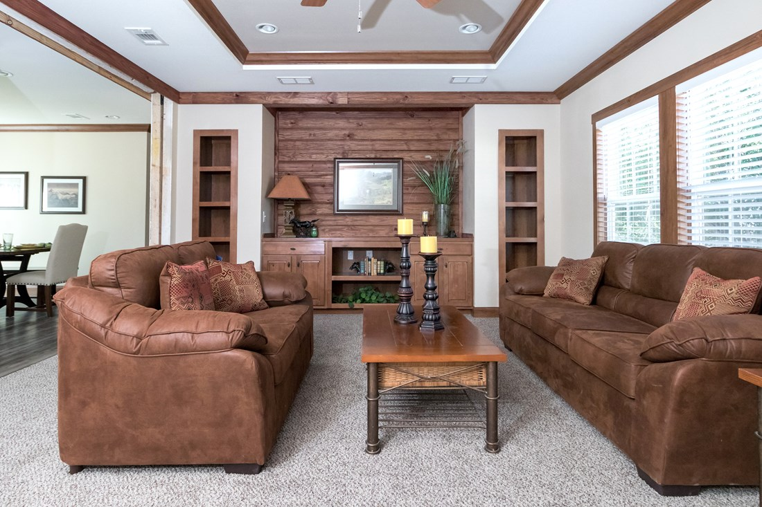 The THE NEWPORT 32 Living Room. This Manufactured Mobile Home features 4 bedrooms and 2 baths.
