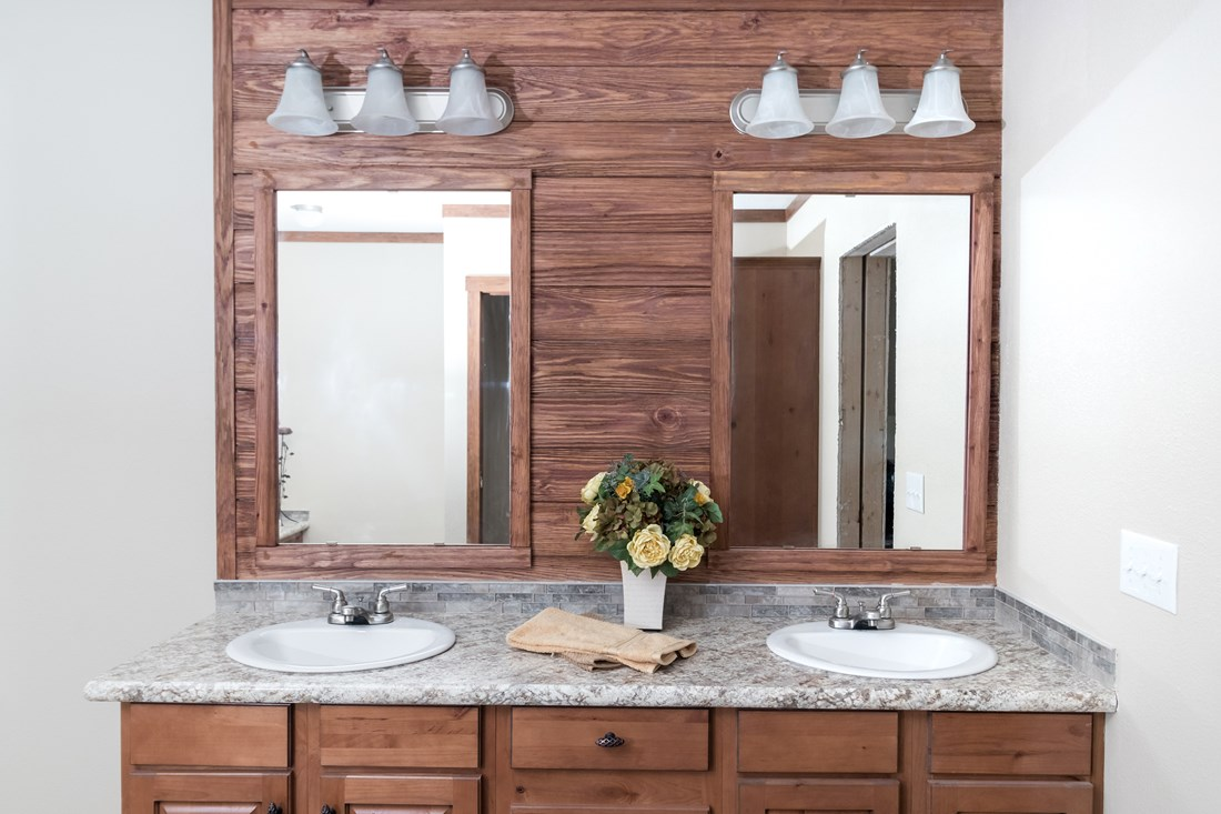 The THE NEWPORT 32 Master Bathroom. This Manufactured Mobile Home features 4 bedrooms and 2 baths.