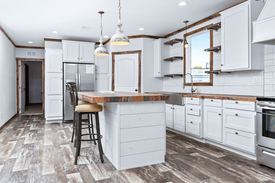 The LILY-MAE Kitchen. This Manufactured Mobile Home features 3 bedrooms and 2 baths.
