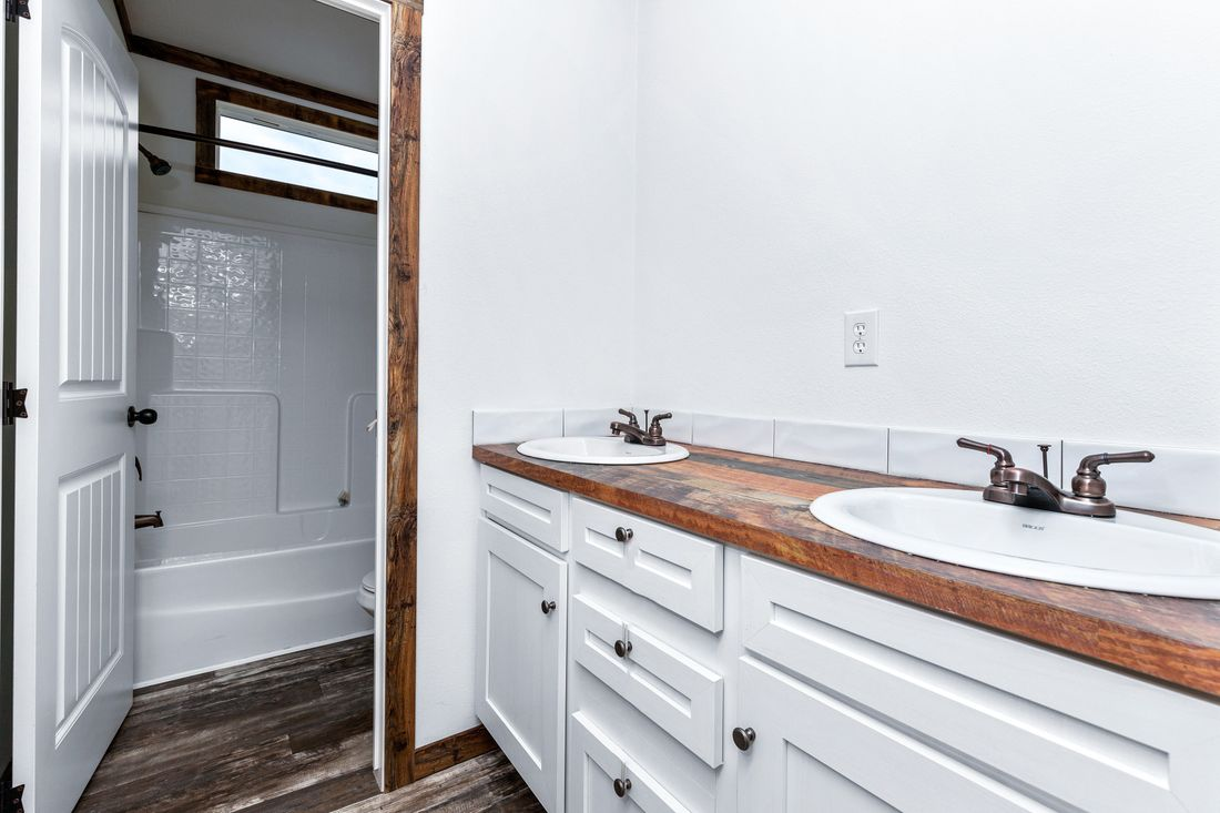 The LILY-MAE Guest Bathroom. This Manufactured Mobile Home features 3 bedrooms and 2 baths.