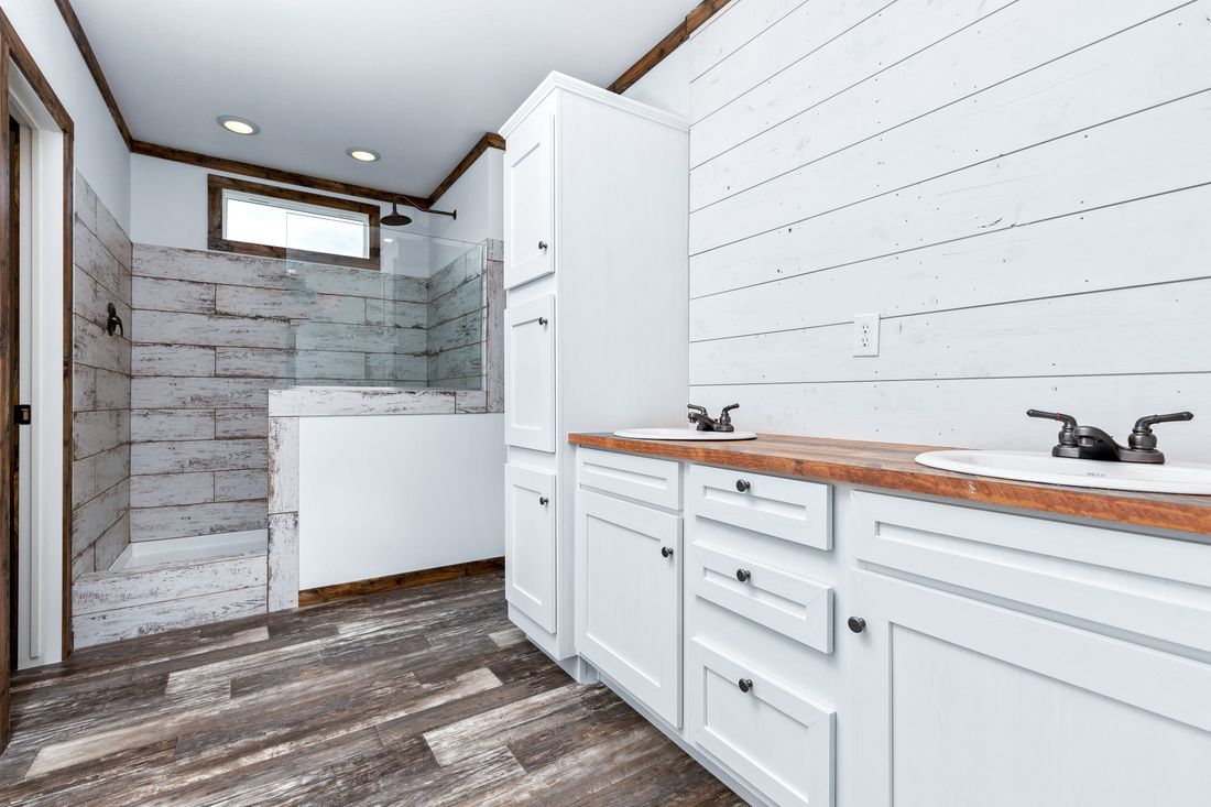 The LILY-MAE Master Bathroom. This Manufactured Mobile Home features 3 bedrooms and 2 baths.