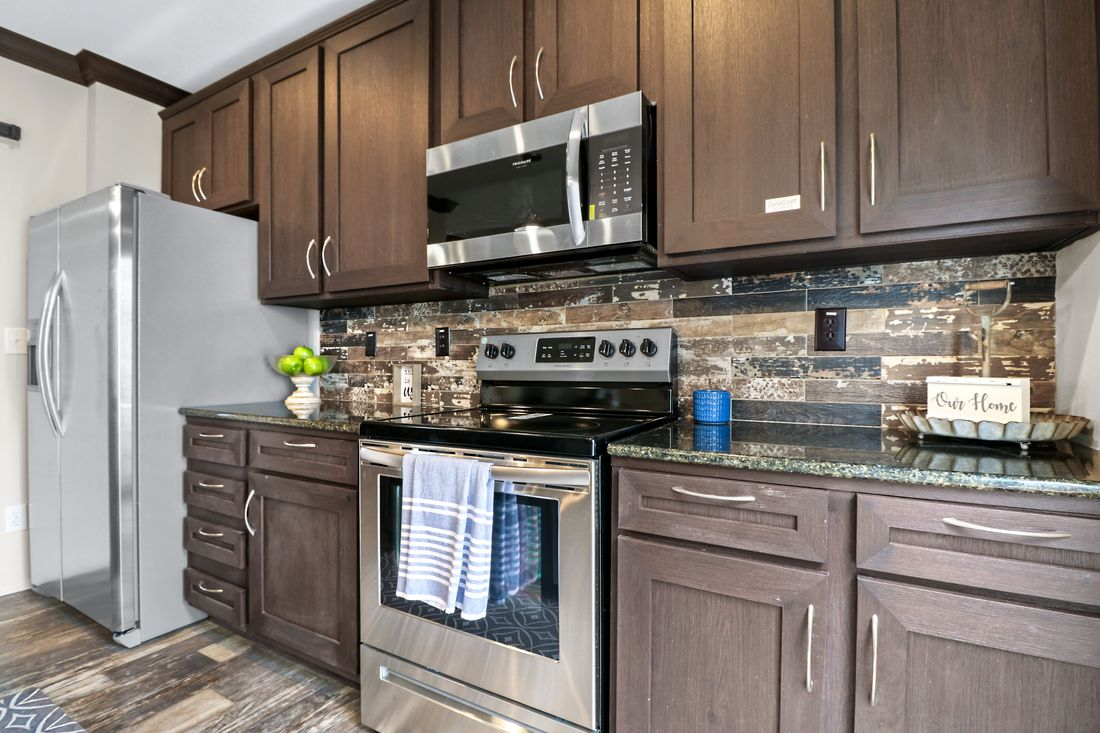 The THE WASHINGTON Kitchen. This Manufactured Mobile Home features 3 bedrooms and 2 baths.