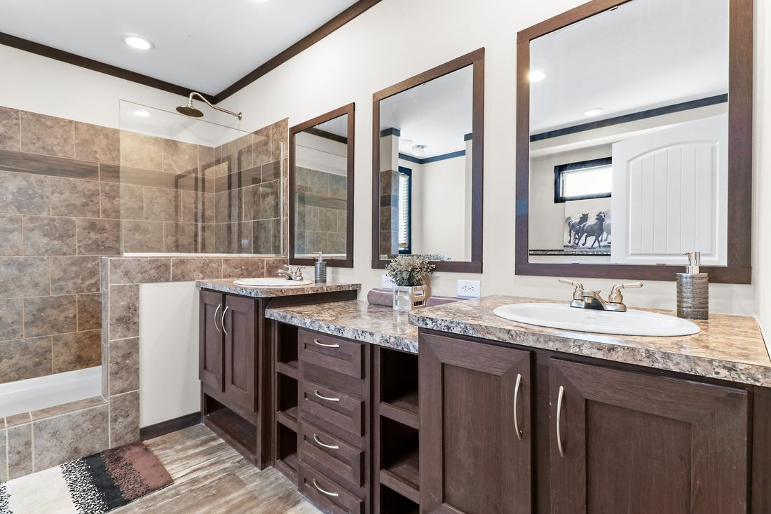 The THE WASHINGTON Master Bathroom. This Manufactured Mobile Home features 3 bedrooms and 2 baths.