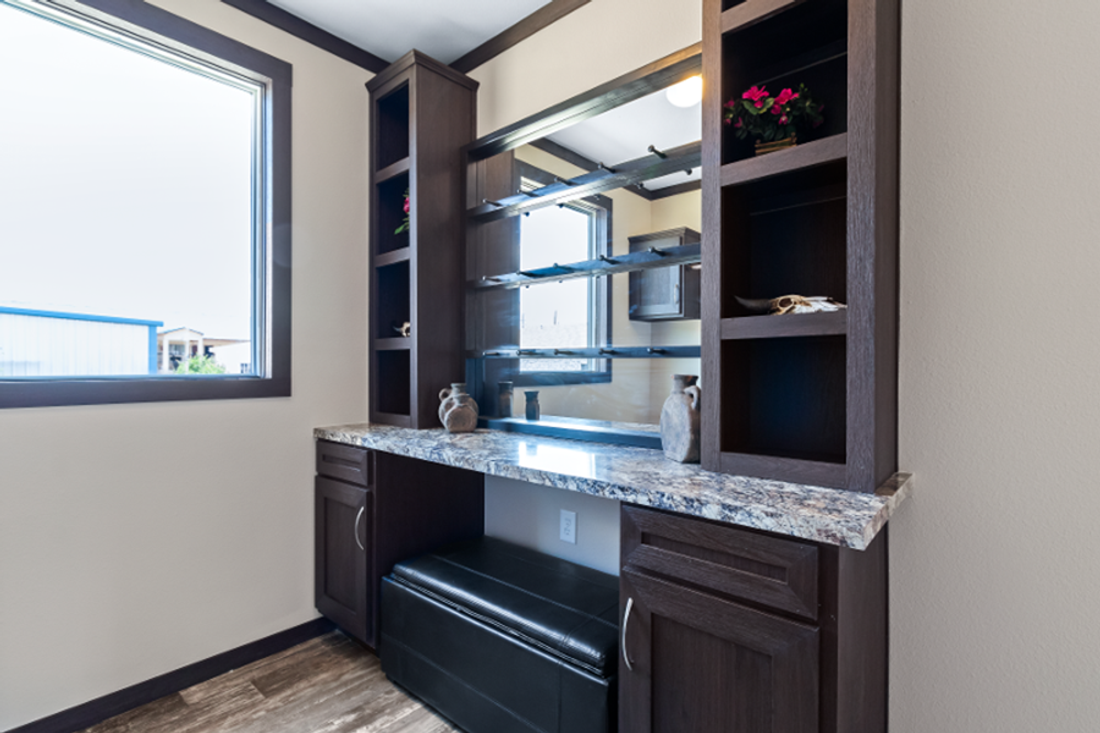 The THE HAMILTON Utility Room. This Manufactured Mobile Home features 5 bedrooms and 3 baths.