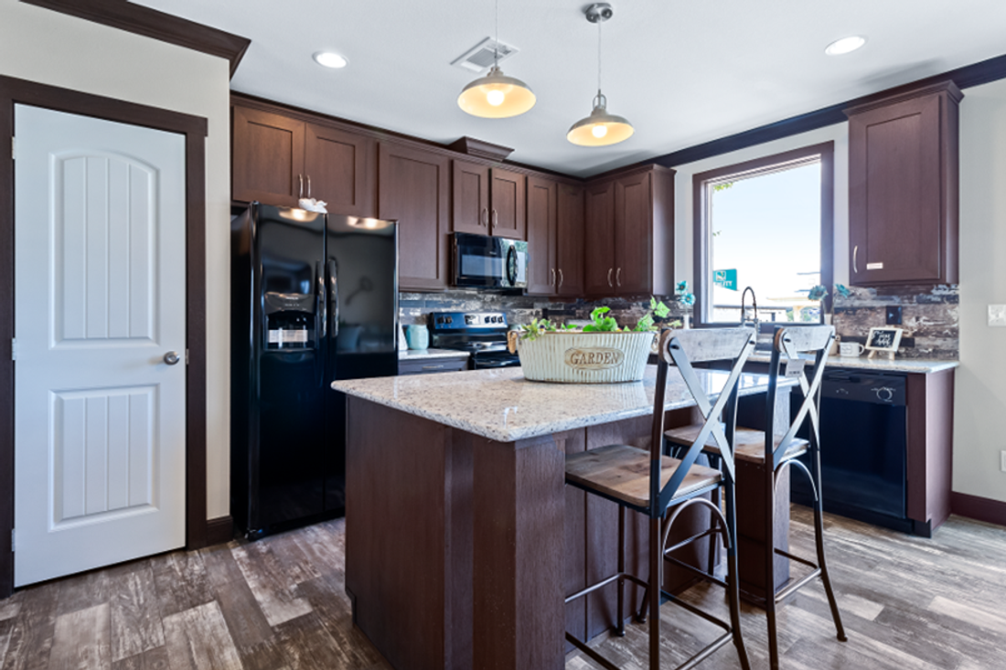 The THE HAMILTON Kitchen. This Manufactured Mobile Home features 5 bedrooms and 3 baths.