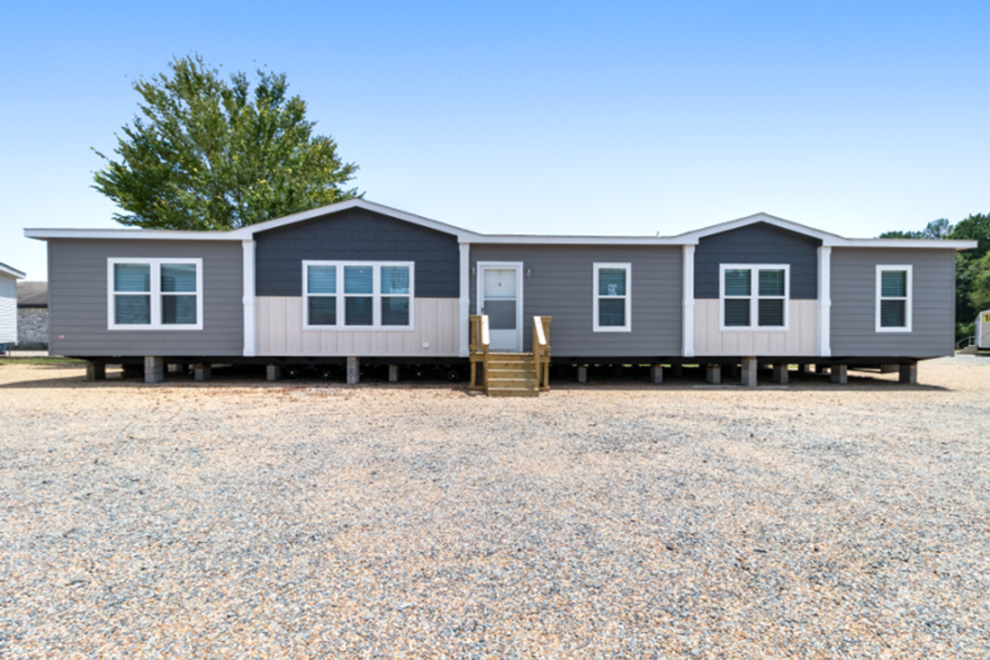 The THE HAMILTON Exterior. This Manufactured Mobile Home features 5 bedrooms and 3 baths.
