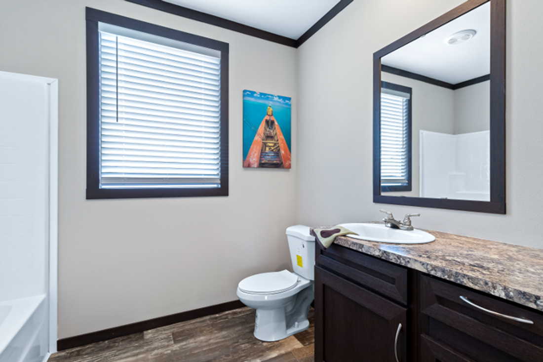 The THE HAMILTON Guest Bathroom. This Manufactured Mobile Home features 5 bedrooms and 3 baths.
