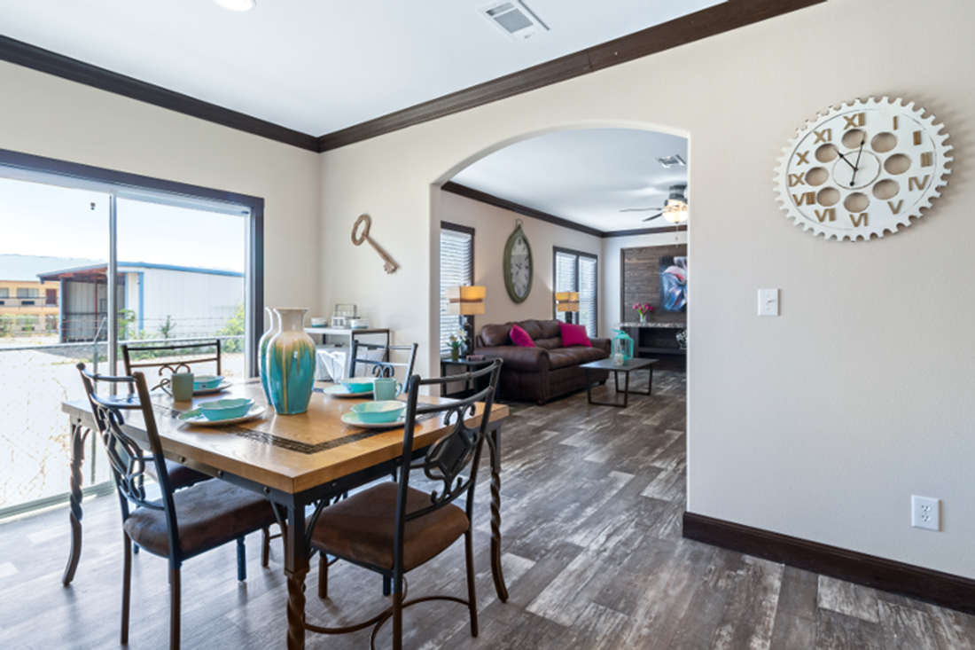The THE HAMILTON Dining Room. This Manufactured Mobile Home features 5 bedrooms and 3 baths.
