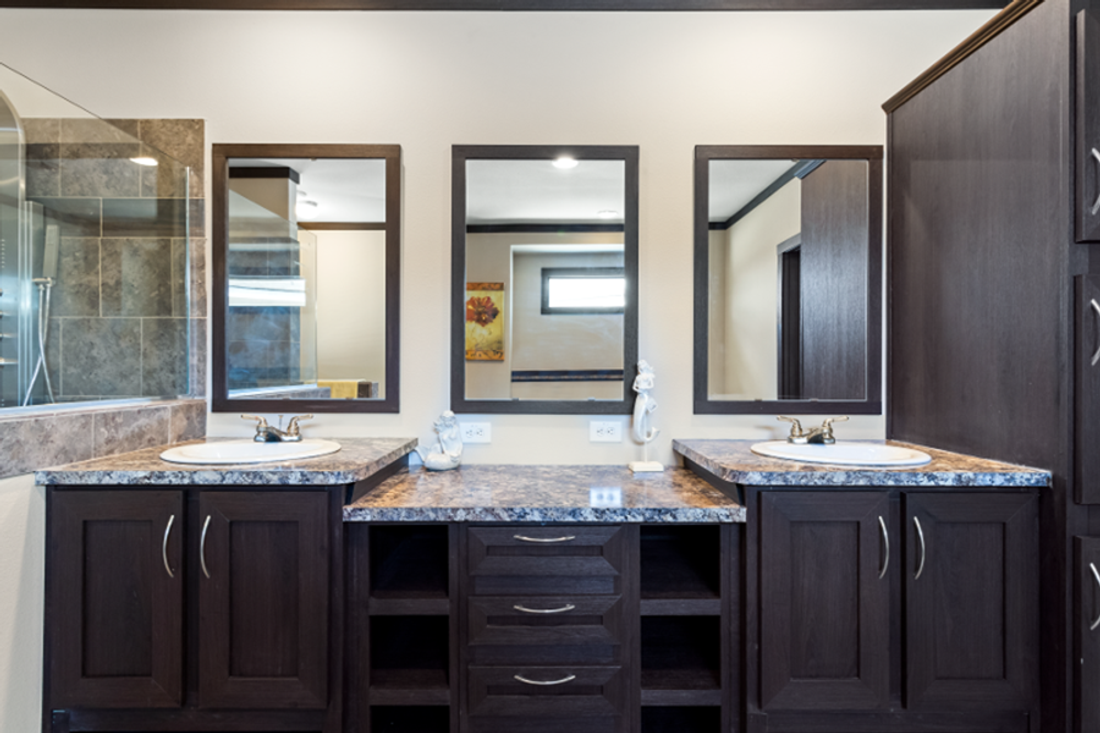 The THE HAMILTON Master Bathroom. This Manufactured Mobile Home features 5 bedrooms and 3 baths.