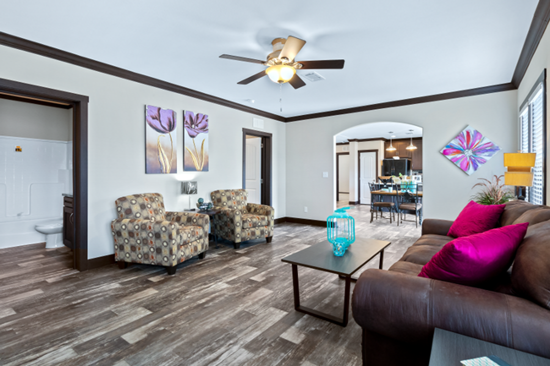 The THE HAMILTON Living Room. This Manufactured Mobile Home features 5 bedrooms and 3 baths.