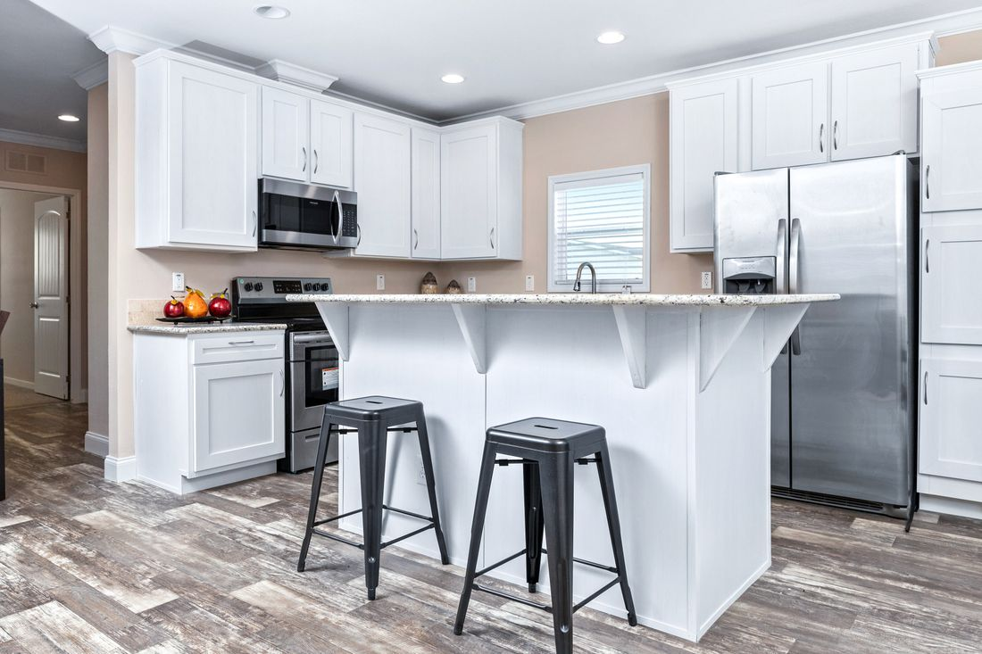 The THE HOGAN 28 Kitchen. This Manufactured Mobile Home features 3 bedrooms and 2 baths.