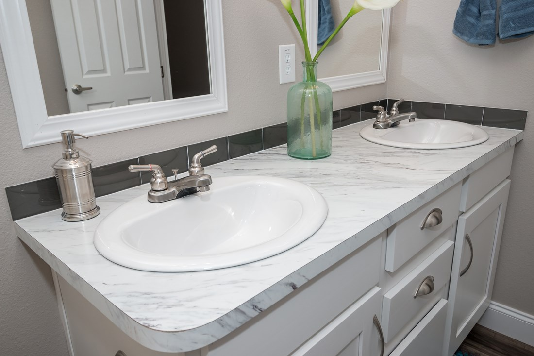 The THE MCILROY Guest Bathroom. This Manufactured Mobile Home features 3 bedrooms and 2 baths.