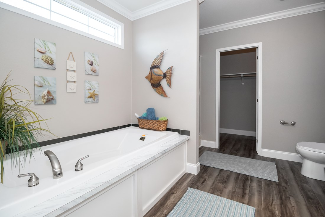 The THE MCILROY Master Bathroom. This Manufactured Mobile Home features 3 bedrooms and 2 baths.
