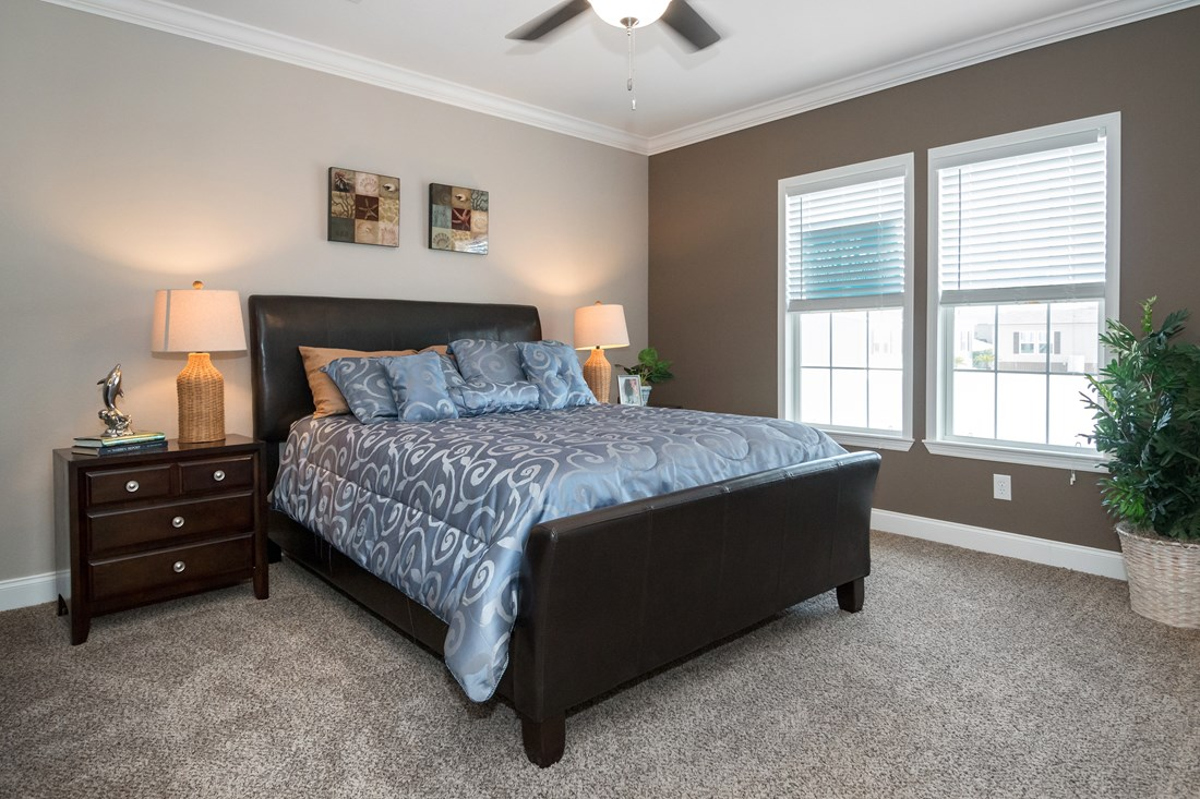 The THE MCILROY Master Bedroom. This Manufactured Mobile Home features 3 bedrooms and 2 baths.
