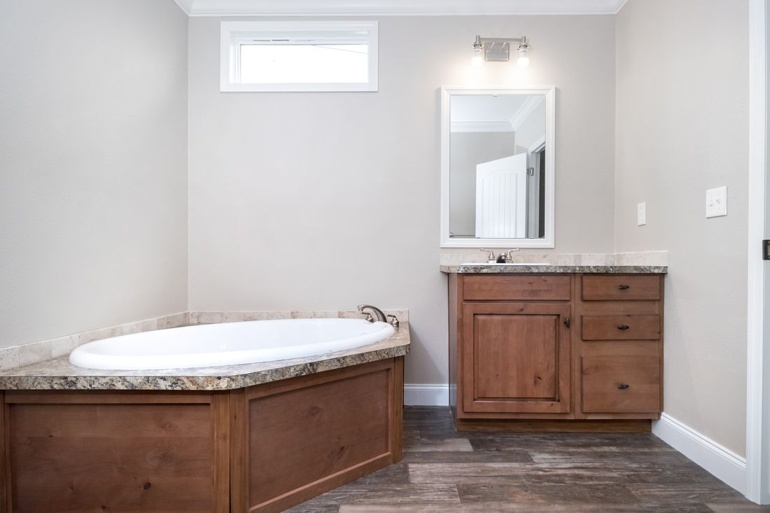 The THE SNEAD Master Bathroom. This Manufactured Mobile Home features 3 bedrooms and 2 baths.