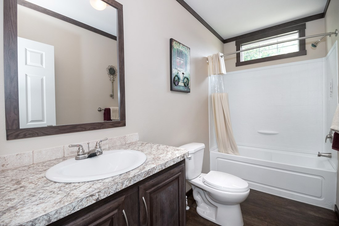 The THE TRENTON 28 Guest Bathroom. This Manufactured Mobile Home features 3 bedrooms and 2 baths.