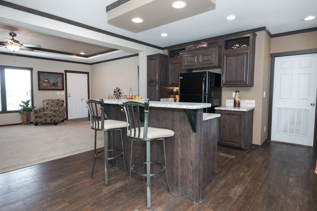 The THE TRENTON 28 Kitchen. This Manufactured Mobile Home features 3 bedrooms and 2 baths.