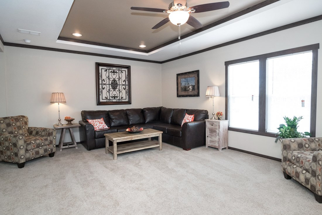 The THE TRENTON 28 Living Room. This Manufactured Mobile Home features 3 bedrooms and 2 baths.