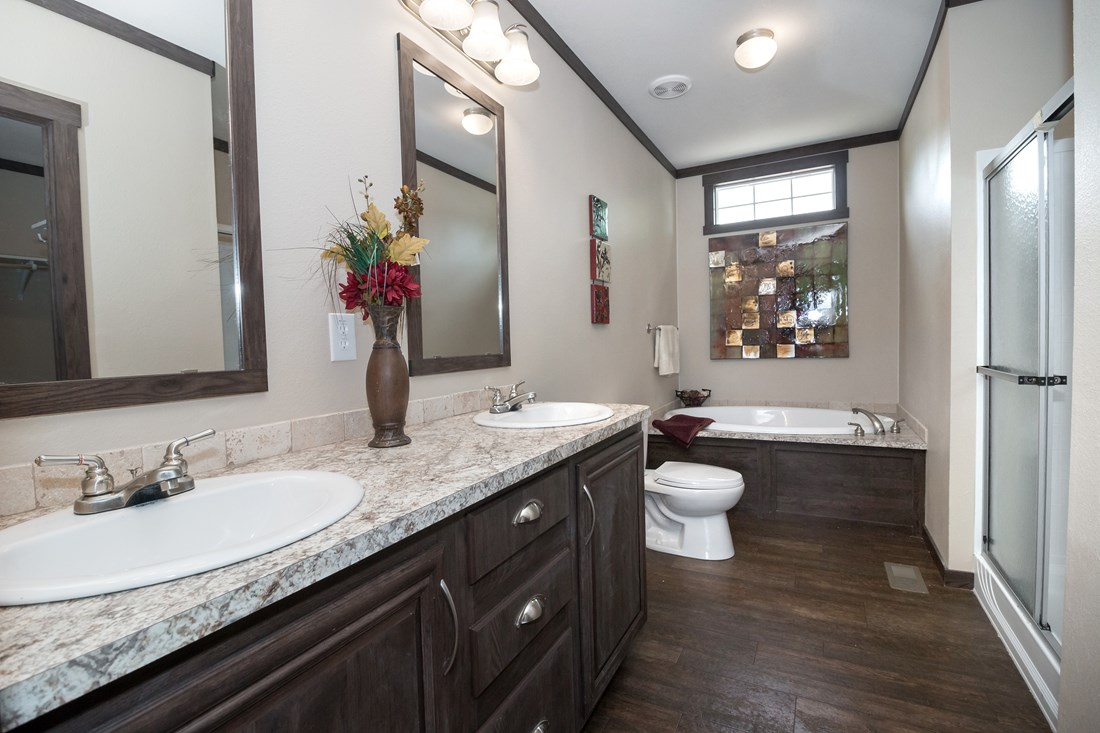 The THE TRENTON 28 Master Bathroom. This Manufactured Mobile Home features 3 bedrooms and 2 baths.