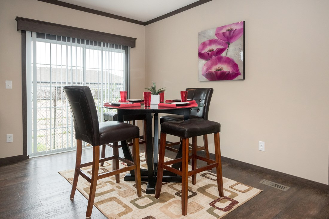 The THE RICHMOND Dining Area. This Manufactured Mobile Home features 3 bedrooms and 2 baths.