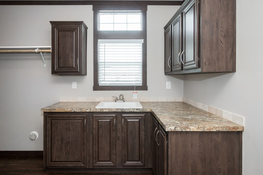 The THE RICHMOND Kitchen. This Manufactured Mobile Home features 3 bedrooms and 2 baths.