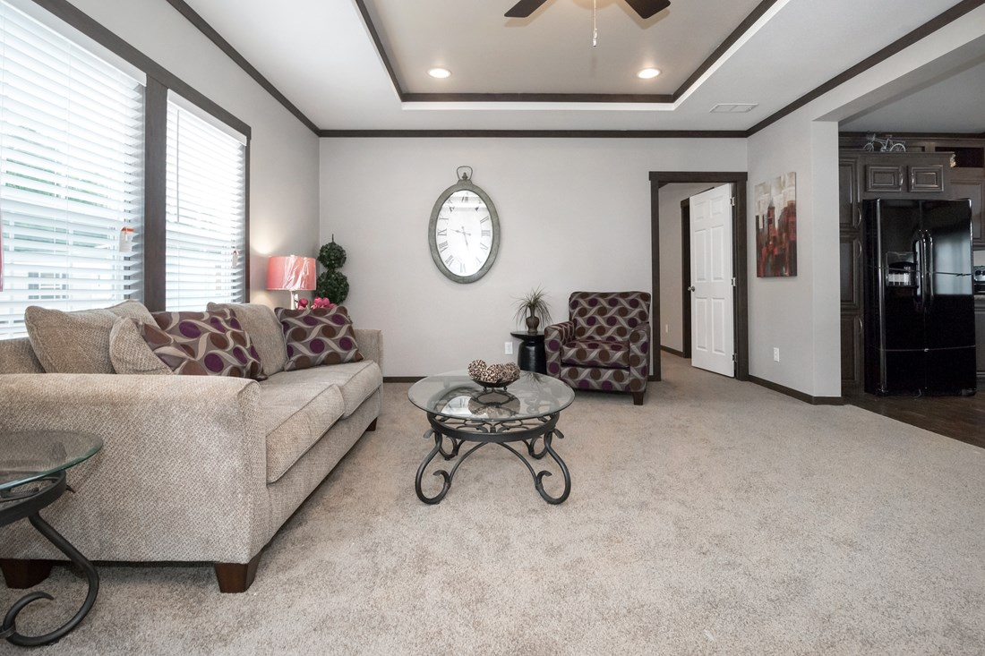 The THE RICHMOND Living Room. This Manufactured Mobile Home features 3 bedrooms and 2 baths.
